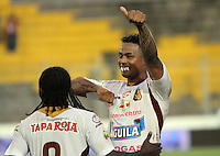 IBAGUE -COLOMBIA- 19-10--2013. Charles Monsalvo  jugador del Deportes Tolima celebra su gol contra el Atletico Junior  Accion de juego correspondiente al partido entre los equipos Deportes Tolima y Atletico Junior  de Barranquilla , partido de la quinceava fecha de la  Liga Postobon segundo semestre jugado en el estadio Manuel Murillo Toro  / Charles Monsalvo Deportes Tolima player celebrates his goal against Atletico Junior Action game for the match between the teams Deportes Tolima and Atletico Junior de Barranquilla, party fifteenth Postobon  League date in the second half played Manuel Murillo Toro stadium .Photo: VizzorImage / Felipe Caicedol / Staff