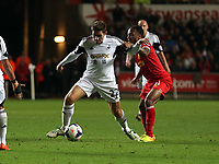 Pictured L-R: Angel Rangel of Swansea against Raheem Sterling of Liverpool. <br /> Monday 16 September 2013<br /> Re: Barclay's Premier League, Swansea City FC v Liverpool at the Liberty Stadium, south Wales.