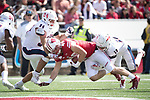 Wisconsin Badgers tight end Kyle Penniston (49) is tackled during an NCAA College Football game against the Florida Atlantic Owls Saturday, September 9, 2017, in Madison, Wis. The Badgers won 31-14. (Photo by David Stluka)