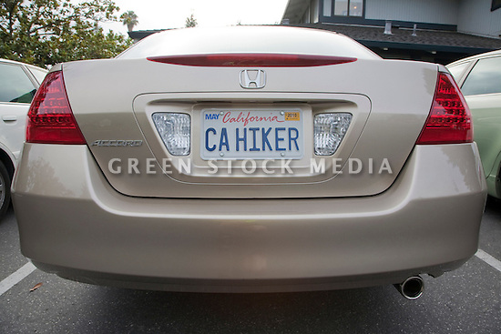 CA HIKER' (California Hiker) personalized license plate on a Honda Accord car. The Bay Area couple who own the vehicle, you guessed it, love to hike. People pay for the customized plates and the proceeds support various causes. The fees collected for these white custom plates go to support environmental programs in California, USA