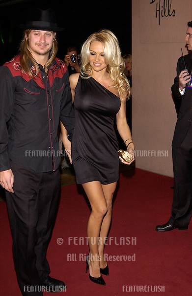Rock star KID ROCK & girlfriend actress PAMELA ANDERSON at pre-Grammy party given by Clive Davis of J Records at the Beverly Hills Hotel..25FEB2002  © Paul Smith / Featureflash