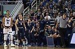 Nevada forward Trey Porter (15) and the Nevada bench react after a turnover against Utah State in the first half of an NCAA college basketball game in Reno, Nev., Wednesday, Jan. 2, 2019. (AP Photo/Tom R. Smedes)