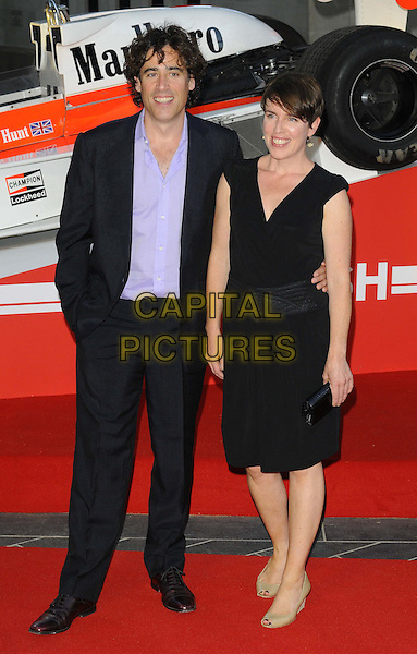 Stephen Mangan &amp; guest<br /> 'Rush' world film premiere at the Odeon Leicester Square cinema, London, England.<br /> 2nd September 2013<br /> full length black suit purple shirt dress<br /> CAP/CAN<br /> &copy;Can Nguyen/Capital Pictures