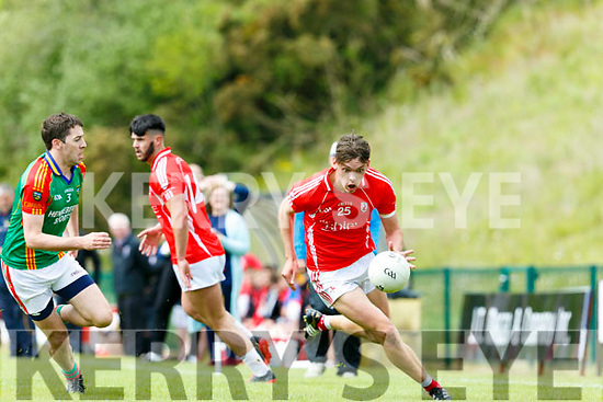 In Action E. Kerry's David Clifford and M.Kerry's Ger Hartnett  at the  Garveys Supervalu Senior County Football Championship Round 2B East Kerry V Mid Kerry at Dr Crokes Lewis Road Killarney on Sunday