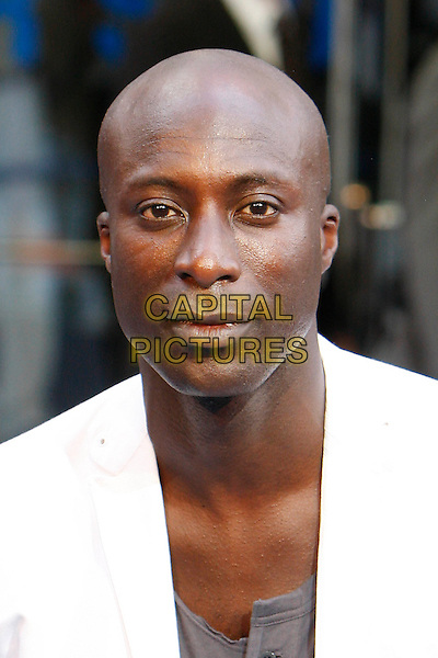 OZWALD BOATENG.The World Premiere of 'Inception' at the Odeon Leicester Square cinema, Leicester Square, London, England, UK. .July 8th 2010 .headshot portrait white grey gray.CAP/MAR.© Martin Harris/Capital Pictures.
