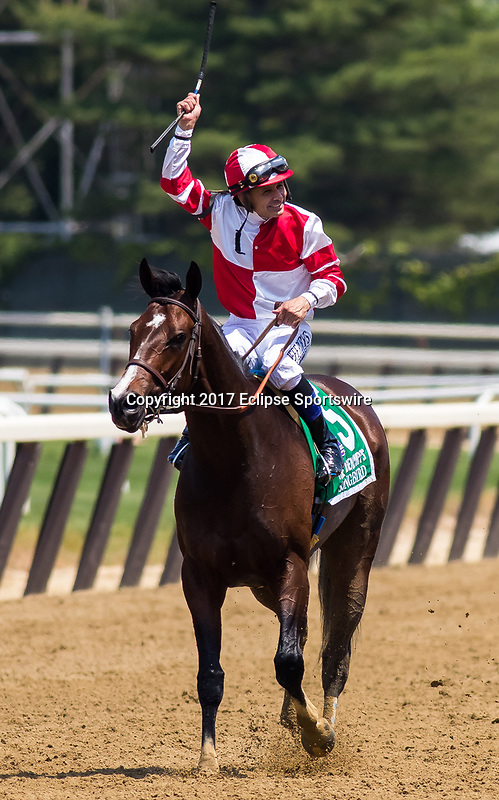 ELMONT, NY - JUNE 10: Mike Smith, aboard Songbird #5, celebrates after winning the Ogden Phipps Stakes on Belmont Stakes Day at Belmont Park on June 10, 2017 in Elmont, New York (Photo by Jesse Caris/Eclipse Sportswire/Getty Images)