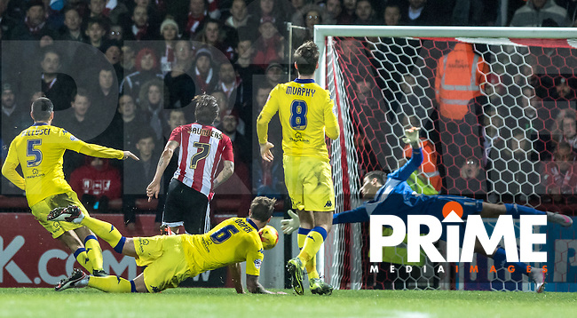 Sam Saunders of Brentford scores the opening goal of the match during the Sky Bet Championship match between Brentford and Leeds United at Griffin Park, London, England on 26 January 2016. Photo by Andy Rowland / PRiME Media Images.