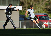 Dan Carter practices dropkicking for goal under pressure from backs coach Wayne Smith. All Blacks Training Session at Rugby League Park, Newtown, Wellington. Thursday 17 September 2009. Photo: Dave Lintott/lintottphoto.co.nz