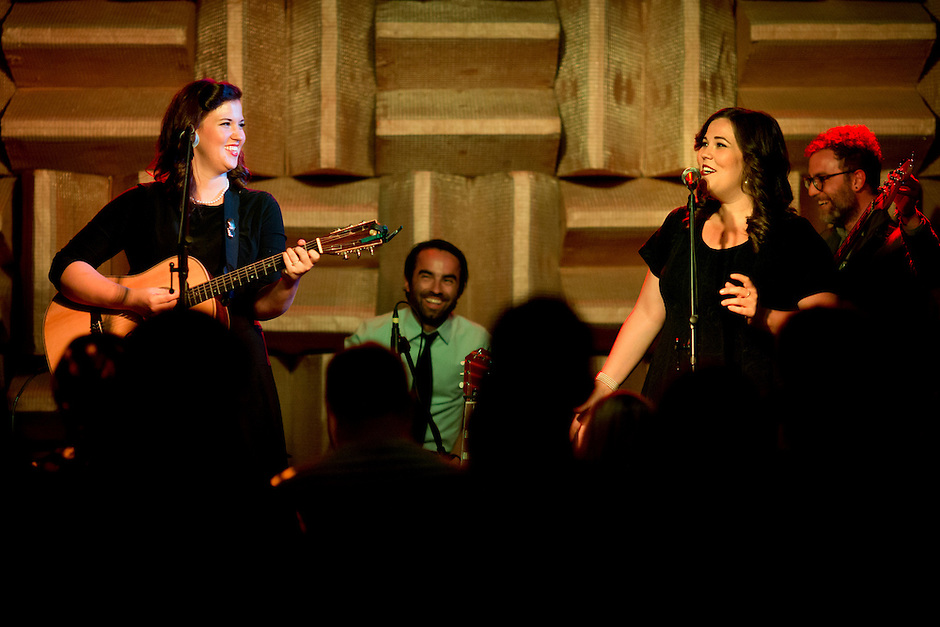 Lydia Rogers, left, shares a laugh with sister Laura Rogers during a performance of their band, The Secret Sisters, on Sunday, July 13, 2014, at The Hi-Fi in Indianapolis. (Photo by James Brosher)
