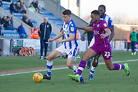 Diaz Wright of Colchester United is pushed to the sidelines by Kelvin Etuhu of Carlisle United during Colchester United vs Carlisle United, Sky Bet EFL League 2 Football at the JobServe Community Stadium on 23rd February 2019