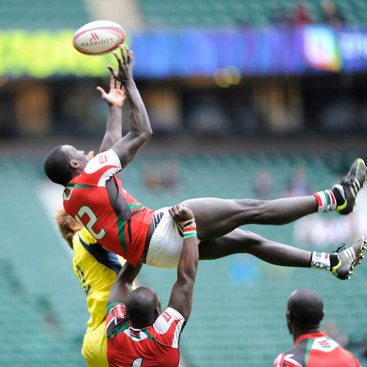 Michael Agevi of Kenya juggles the re-start ball during Day Two of the iRB Marriott London Sevens at Twickenham on Sunday 11th May 2014 (Photo by Rob Munro)