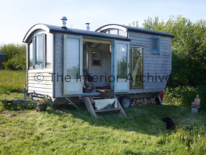 The shepherd's hut has been constructed predominantly of wood with a twin skin, ply insulation and a waterproof membrane. It rests on a twin-axle trailer base, which makes it easy to move to a different location