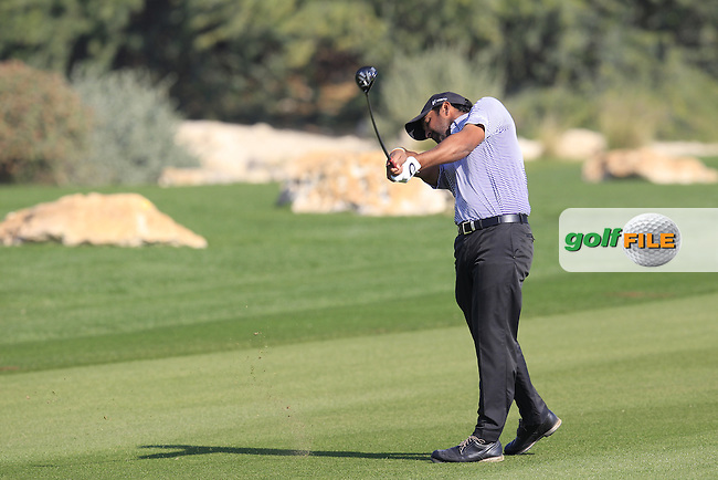 Shiv KAPUR (IND) plays his 2nd shot on the 9th hole during Thursday's Round 2 of the 2015 Commercial Bank Qatar Masters held at Doha Golf Club, Doha, Qatar.: Picture Eoin Clarke, www.golffile.ie: 1/22/2015