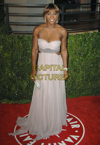 SERENA WILLIAMS.The 2010 Vanity Fair Oscar Party held at The Sunset Tower Hotel in West Hollywood, California, USA..March 7th, 2010.oscars full length white purple lilac pink strapless dress gown cut out sides silver  beads beaded .CAP/RKE/DVS.©DVS/RockinExposures/Capital Pictures.