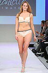 Model walks runway in lingerie from Montelle Intimates, during the Lingerie Fashion Night - Romancing The Runway show, by CurvExpo and Lycra on February 23, 2015.