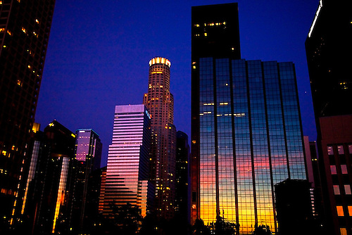 Downtown Los Angeles at early evening as the sunset is reflected off the skyline