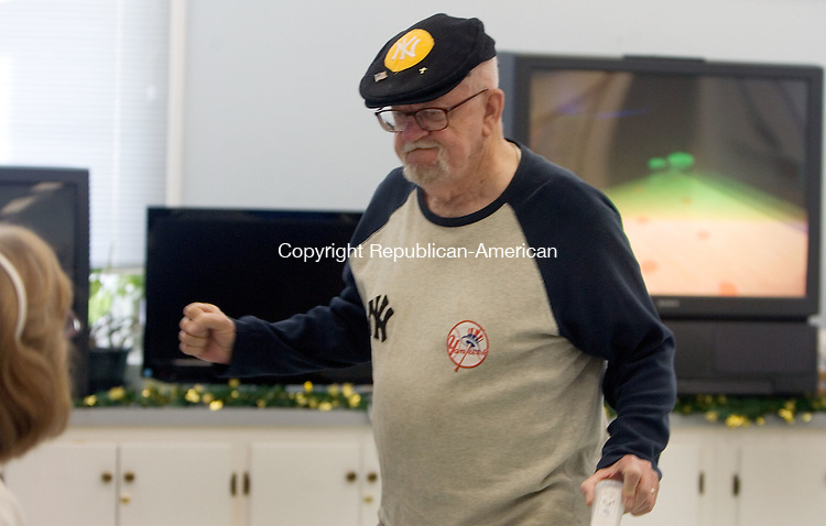 WATERTOWN, CT. 02 January 2013-010213SV01-Walt Belsito of Wolcott does a little victory dance after getting a strike during a weekly Wii bowling tournament at the Falls Avenue Senior Center in Watertown Wednesday.  Steven Valenti Republican-American