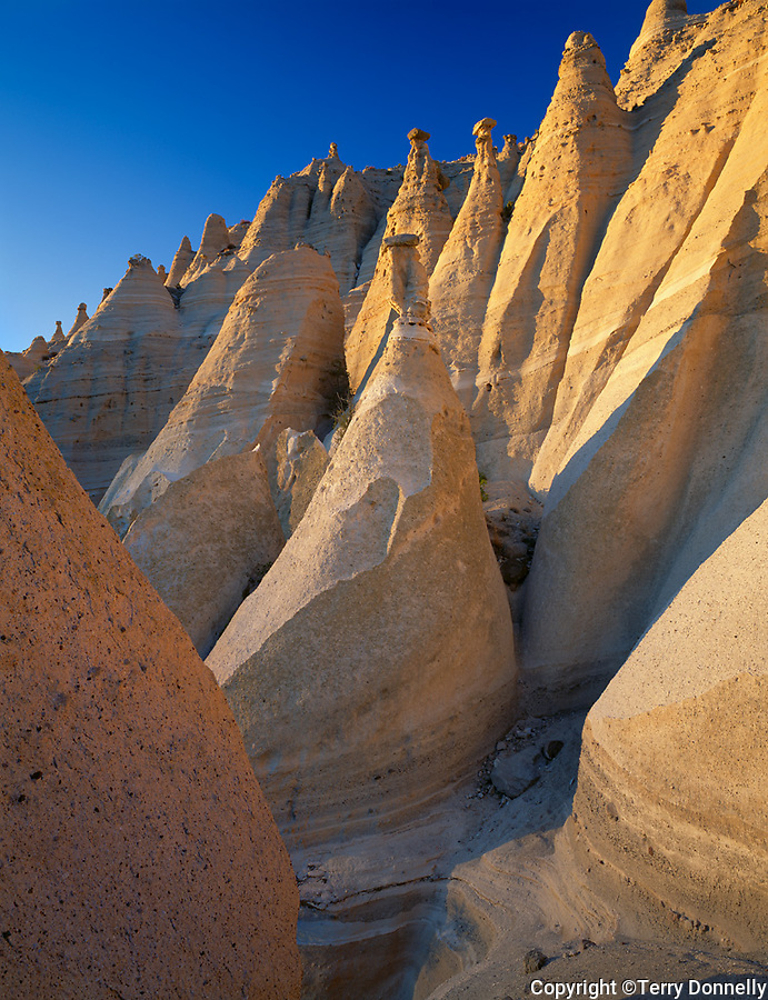Tent Rocks National Monument, NM<br /> Warm light on cone shaped rocks of eroded volcanic ash at Kasha-Katuwe Tent Rocks National Monument