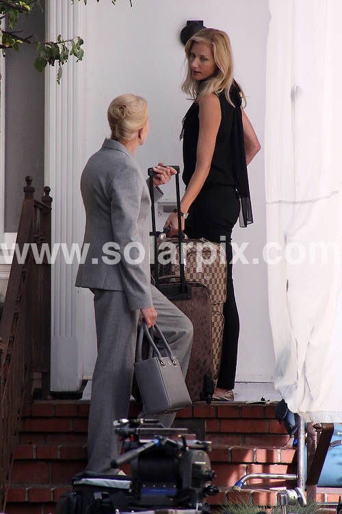 **ALL ROUND EXCLUSIVE PICTURES FROM SOLARPIX.COM**.**WORLDWIDE SYNDICATION RIGHTS**.**NO PUBLICATION IN AUSTRALIA, NEW ZEALAND,.DENMARK, GERMANY OR USA**.Mother and daughter actresses Vanessa Redgrave and Joely Richardson filming on the Nip/Tuck film set in Venice, California, USA. Tuesday 2nd December 2008..This pic: Joely Richardson and Vanessa Redgrave..JOB REF: 8063 LAP (NBAS)      DATE: 02_12_2008.**MUST CREDIT SOLARPIX.COM OR DOUBLE FEE WILL BE CHARGED* *UNDER NO CIRCUMSTANCES IS THIS IMAGE TO BE REPRODUCED FOR ANY ONLINE EDITION WITHOUT PRIOR PERMISSION*