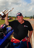 Apr. 29, 2012; Baytown, TX, USA: NHRA top alcohol funny car driver Jay Payne celebrates after winning the Spring Nationals at Royal Purple Raceway. Mandatory Credit: Mark J. Rebilas-