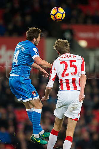 19.11.2016. Bet365 Stadium, Stoke, England. Premier League Football. Stoke City versus AFC Bournemouth. Bournemouth midfielder Dan Gosling gets closer to the ball than Stoke City forward Peter Crouch.