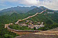 A section of the Great Wall of China near Beijing.  The sign promoting the Beijing Olympics is visibale.