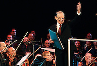 Il compositore Ennio Morricone con l'orchestra La Sinfonietta sul palco del tradizionale concerto del Primo Maggio organizzato da Cgil, Cisl e Uil in piazza San Giovanni, Roma, 1 maggio 2011..Italian composer and conductor Ennio Morricone with La Sinfonietta orchestra on stage at St. John in Lateran's Square, Rome, 1 may 2011, for the traditional May Day concert..UPDATE IMAGES PRESS/Riccardo De Luca