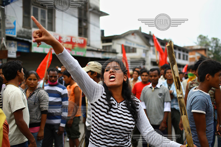 A young woman points angrily at a strike called by the Unified Communist Party of Nepal (UCPN) to remove the ruling government. The Maoist opposition blocked streets leading to key government offices on the 6th May, the fifth day of their crippling general strike to demand the prime minister's resignation, but the government has vowed not to bow to the protesters' pressure. The Maoists, known to use violence to back their strike calls, have demanded that residents halt all travel and keep businesses and schools closed since Sunday in their campaign to get Prime Minister Madhav Kumar Nepal to resign and hand power to a Maoist-led government. The strike has shut down most businesses, schools and transport, with daily activity grinding to a standstill.