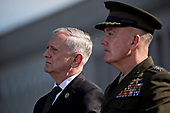 Jim Mattis, U.S. Secretary of Defense, left, and General Joseph Dunford, Chairman of the Joint Chiefs of Staff, listen during a ceremony to commemorate the September 11, 2001 terrorist attacks with U.S. President Donald Trump, not pictured, at the Pentagon in Washington, D.C., U.S., on Monday, Sept. 11, 2017. Trump is presiding over his first 9/11 commemoration on the 16th anniversary of the terrorist attacks that killed nearly 3,000 people when hijackers flew commercial airplanes into New York's World Trade Center, the Pentagon and a field near Shanksville, Pennsylvania. <br /> Credit: Andrew Harrer / Pool via CNP