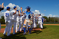 South Dakota State Jackrabbits catcher Derek Hackman high fives teammates after a game against the FIU Panthers on February 23, 2019 at North Charlotte Regional Park in Port Charlotte, Florida.  South Dakota State defeated FIU 4-3.  (Mike Janes/Four Seam Images)