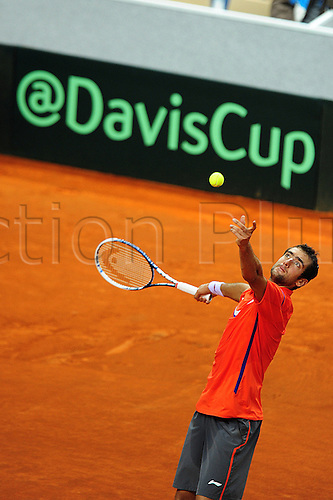 01.02.2013 Turin, Italy.Marin Cilic in action against during the opening round tie of the Davis Cup between Italy and Croatia from Palavela.