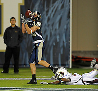 6 November 2010:  FIU wide receiver Greg Ellingson (82) pulls in a reception for a touchdown in the first quarter as the FIU Golden Panthers defeated the University of Louisiana-Monroe Warhawks, 42-35 in double overtime, at FIU Stadium in Miami, Florida.