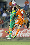 14 September 2013: Tampa Bay's Georgi Hristov (BUL) (left) and Carolina's Kevin Rutkiewicz (SCO) (16) challenge for a header. The Carolina RailHawks played the Tampa Bay Rowdies at WakeMed Stadium in Cary, North Carolina in a North American Soccer League Fall 2013 Season regular season game. The game ended in a 2-2 tie.