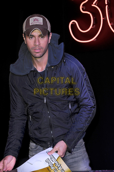 LONDON, UK, MARCH 27:  Enrique Iglesias meets fans and signs copies of his new album 'Sex + Love' at HMV, Oxford Street on March 27th, 2014 in London, England. <br /> CAP/CJ<br /> &copy;Chris Joseph/Capital Pictures