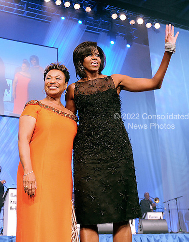 Washington, DC - September 26, 2009 -- United States Representative Barbara Lee (Democrat of California), the 21st chair of the Congressional Black Caucus, introduces the first lady  on stage at the Congressional Black Caucus Foundation's Annual Phoenix Awards Dinner at the Walter E. Washington Convention Center on Saturday, September 26, 2009  in Washington D.C..Credit: Olivier Douliery  / Pool via CNP