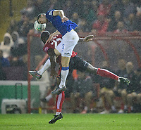Lincoln City's John Akinde vies for possession with Everton's Michael Keane<br /> <br /> Photographer Chris Vaughan/CameraSport<br /> <br /> The Carabao Cup Second Round - Lincoln City v Everton - Wednesday 28th August 2019 - Sincil Bank - Lincoln<br />  <br /> World Copyright © 2019 CameraSport. All rights reserved. 43 Linden Ave. Countesthorpe. Leicester. England. LE8 5PG - Tel: +44 (0) 116 277 4147 - admin@camerasport.com - www.camerasport.com