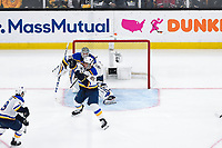 June 6, 2019: St. Louis Blues defenseman Vince Dunn (29) gloves the puck in front of goaltender Jordan Binnington (50) during game 5 of the NHL Stanley Cup Finals between the St Louis Blues and the Boston Bruins held at TD Garden, in Boston, Mass. The Blues defeat the Bruins 2-1 in regulation time. Eric Canha/CSM