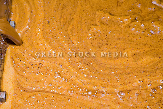 Close-up of freshly extracted palm oil crude. The Sindora Palm Oil Mill, owned by Kulim, is green certified by the Roundtable on Sustainable Palm Oil (RSPO) for its environmental, economic, and socially sustainable practices. Johor Bahru, Malaysia