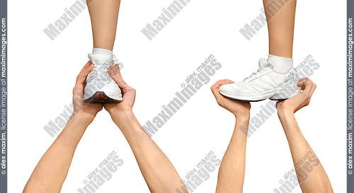 Two strong male hands holding one female foot. Teamwork, support, help, gymnastics, competition concepts. Isolated silhouette on white background