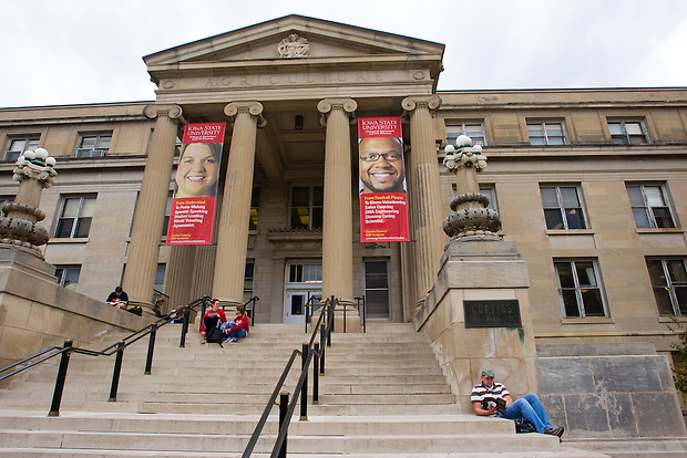 Agriculture business student Gunnar Hansen of Kankakee, Ill., lower right, reads on the steps of Curtiss Hall on the campus of Iowa State University in Ames, Iowa. (Christopher Gannon/Gannon Visuals)