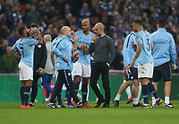 Manchester City manager Josep Guardiola gives a team talk prior to extra time<br /> <br /> Photographer Rob Newell/CameraSport<br /> <br /> The Carabao Cup Final - Chelsea v Manchester City - Sunday 24th February 2019 - Wembley Stadium - London<br />  <br /> World Copyright © 2018 CameraSport. All rights reserved. 43 Linden Ave. Countesthorpe. Leicester. England. LE8 5PG - Tel: +44 (0) 116 277 4147 - admin@camerasport.com - www.camerasport.com