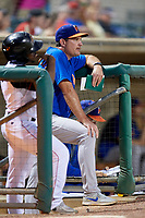 Midland RockHounds hitting coach Brian McArn (24) in the dugout during a game against the Arkansas Travelers on May 25, 2017 at Dickey-Stephens Park in Little Rock, Arkansas.  Midland defeated Arkansas 8-1.  (Mike Janes/Four Seam Images)