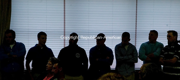 SOUTHBURY, CT -08 MAY 2006 -050806JT07--<br /> Seven Southbury firefighters stand in a meeting room at the Southbury Center Firehouse on Monday night before a general membership meeting in which they pleaded their case not to be expelled from the fire department after they were accused of posting negative comments on MySpace.com about the department leadership. <br /> Josalee Thrift Republican-American