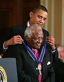Washington, DC - August 12, 2009 -- United States President Barack Obama (R) presents Archbishop Emeritus Desmond Mpilo Tutu the 2009 Medal of Freedom. The award is the highest honor a civilian can achieve for being recognized for their outstanding achievements in life. The award were given to Stephen Hawking, Ted Kennedy, Billie Jean King, Harvey Milk (posthumously) , Sandra Day O'Connor, Desmond Tutu, Dr. Pedro Jose Greer, Nancy Goodman Brinker, Jack Kemp (posthumously), Reverend Joseph Lowery, Dr. Joseph Medicine Crow, Mary Robinson, Janet Davison Rowley, Dr. Muhammad Yunus, Chita Rivera, and Sidney Poitier..Credit: Gary Fabiano / Pool via CNP