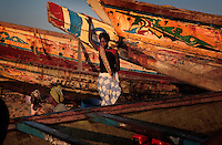Senevisa Shrimp processing plant in Ziguinchor (Casamance Region).  Contact for this plant (run by Senevisa) is Omais Rami +221 644 4779..Photos of women with dugout canoes is in town of Karountine, NW of Ziguinchor...Contacts at plant are:.Claude Prosper Dieme, head of production prosper@vierasa.sn.and Laurent Sina, Quality Control, lsina@vieirasa.sn..Eduardo Viera SA:  I met Eduardo in Vigo Spain at his headquarters.  He has many fishing and factory operations all over the world including 9 factory ships and two processing plants in Senegal...Anibal Serafin Fernandez Souto is the guy in charge for Eduardo in Senegal.  His mobile is +221 638 5152.Nouveau Quai de Peche.B.P. 1557 Dakar Senegal.+221 889 6868 office.823 6861 fax.senevisa@vieirasa.sn.www.vierasa.sn.home address:.Avda Orillamar.B.P. 1075  36202 Vigo Spain.986 21 32 00 home..Industrialized fishermen pay a license to fish, but then there is no limit for how much they can catch.  The artesenal fishermen are not regulated in any way.  The govt is realizing they have to have some control and banned fishing in November and are opening 5 MPA's...600,000 Senegalese participate in the fishing industry.  When you multiply that number times the 6 or 7 kids they each have and other dependents, you can see that this is a significant percentage of the 12 million Senegalese.  Eighty percent of the fish caught are caught by artesinal fishermen.
