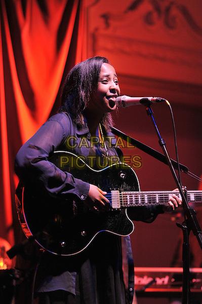 Al Spx of Cold Specks performing live in concert, Bush Hall, Shepherd's Bush, London, England.28th February 2012.on stage gig performance music half length black top guitar singing profile .CAP/MAR.© Martin Harris/Capital Pictures.