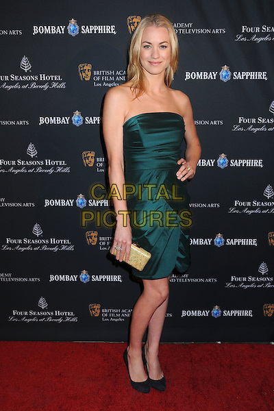 YVONNE STRAHOVSKI .17th Annual BAFTA Los Angeles Awards Season Tea Party held at the Four Seasons Hotel, Beverly Hills, California, USA, 15th January 2011..full length strapless green dress hand on hip black shoes gold clutch bag .CAP/ADM/BP.©Byron Purvis/AdMedia/Capital Pictures.