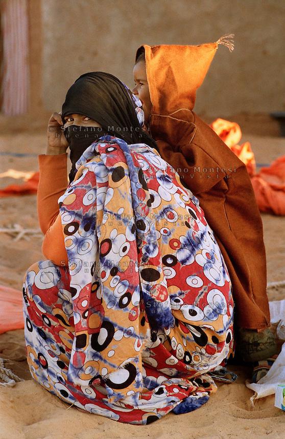 The Saharawi refugee camp  Smara..Sahrawi mother and son