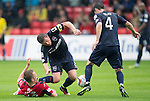 Ross County v St Johnstone...10.08.14  SPFL<br /> Richie Brittain is tackled by Scott Brown<br /> Picture by Graeme Hart.<br /> Copyright Perthshire Picture Agency<br /> Tel: 01738 623350  Mobile: 07990 594431