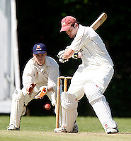 Ed Binns bats for Highgate during the Middlesex County Cricket League game between Highgate and Barnes at Park Road, Crouch End, London on Sat May 22, 2010
